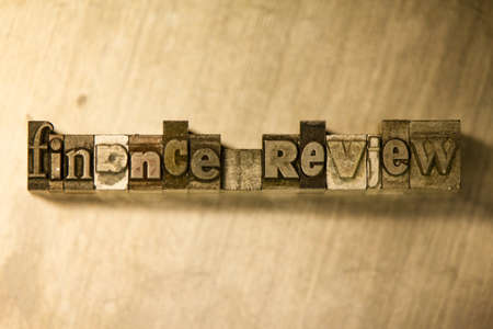 review: Lead metal Finance review letterpress text on wooden background Stock Photo