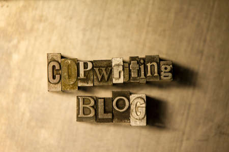 copywriting: Bronze metal Copywriting blog typography lettering on wooden background