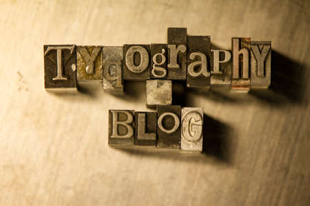 Lead metal Typography blog symbols text on wooden background