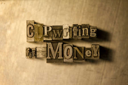 copywriting: Bronze Copywriting for money typography lettering on wooden background Stock Photo