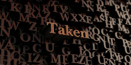 taken: Taken - Wooden 3D rendered lettersmessage.  Can be used for an online banner ad or a print postcard.