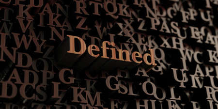 defined: Defined - Wooden 3D rendered lettersmessage.  Can be used for an online banner ad or a print postcard. Stock Photo