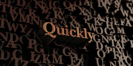 quickly: Quickly - Wooden 3D rendered lettersmessage.  Can be used for an online banner ad or a print postcard. Stock Photo