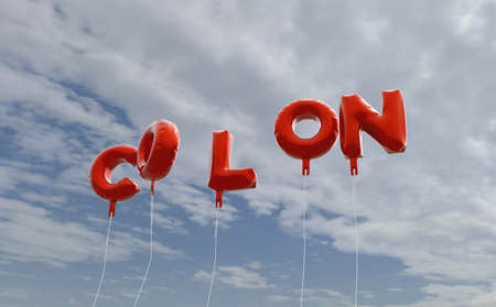 COLON - red foil balloons on blue sky - 3D rendered royalty free stock picture. This image can be used for an online website banner ad or a print postcard. Stock Photo