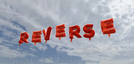 reverse: REVERSE - red foil balloons on blue sky - 3D rendered royalty free stock picture. This image can be used for an online website banner ad or a print postcard. Stock Photo