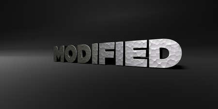 modified: MODIFIED - hammered metal finish text on black studio - 3D rendered royalty free stock photo. This image can be used for an online website banner ad or a print postcard.