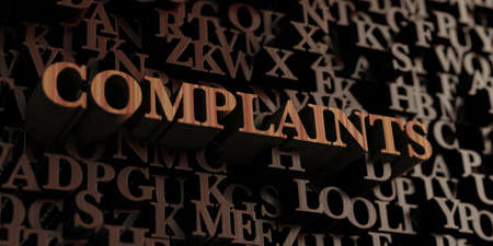 Complaints - Wooden 3D rendered lettersmessage.  Can be used for an online banner ad or a print postcard. Stock Photo