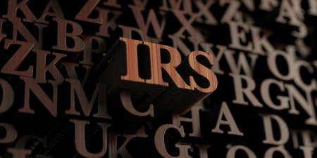 irs: Irs - Wooden 3D rendered lettersmessage.  Can be used for an online banner ad or a print postcard.