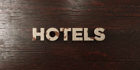 headline: Hotels - grungy wooden headline on Maple  - 3D rendered