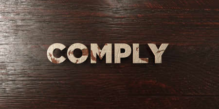 headline: Comply - grungy wooden headline on Maple  - 3D rendered