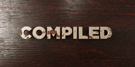 compiled: Compiled - grungy wooden headline on Maple  - 3D rendered royalty free stock image. This image can be used for an online website banner ad or a print postcard. Stock Photo