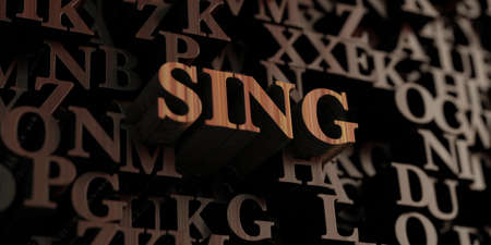 sing: Sing - Wooden 3D rendered lettersmessage.  Can be used for an online banner ad or a print postcard. Stock Photo