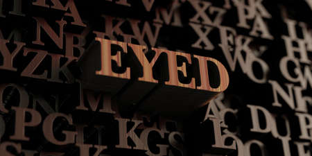 single eyed: Eyed - Wooden 3D rendered lettersmessage.  Can be used for an online banner ad or a print postcard. Stock Photo