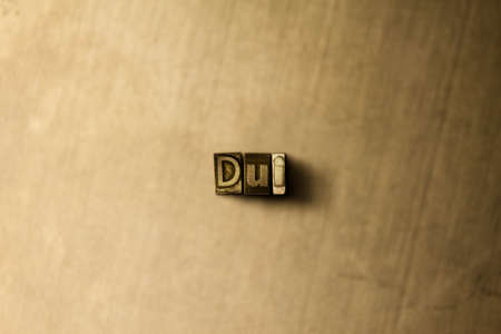 dui: DUI - close-up of grungy vintage typeset word on metal backdrop. Royalty free stock illustration.  Can be used for online banner ads and direct mail.