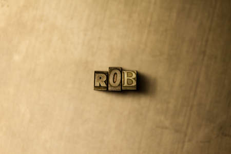 ROB - close-up of grungy vintage typeset word on metal backdrop. Royalty free stock illustration.  Can be used for online banner ads and direct mail. Stok Fotoğraf