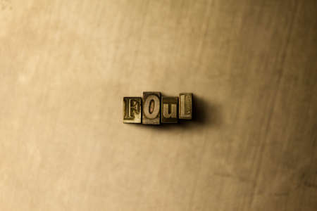 foul: FOUL - close-up of grungy vintage typeset word on metal backdrop. Royalty free stock illustration.  Can be used for online banner ads and direct mail.