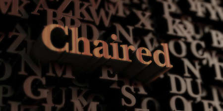 chaired: Chaired - Wooden 3D rendered lettersmessage.  Can be used for an online banner ad or a print postcard.