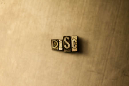 DISC - close-up of grungy vintage typeset word on metal backdrop. Royalty free stock illustration.  Can be used for online banner ads and direct mail. Stock Photo