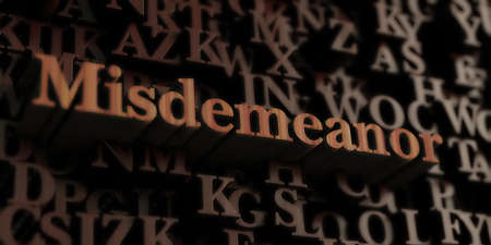 Misdemeanor - Wooden 3D rendered lettersmessage.  Can be used for an online banner ad or a print postcard.