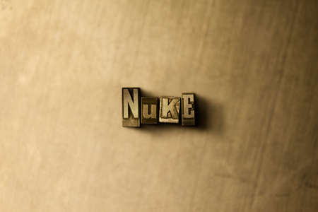 nuke: NUKE - close-up of grungy vintage typeset word on metal backdrop. Royalty free stock illustration.  Can be used for online banner ads and direct mail.