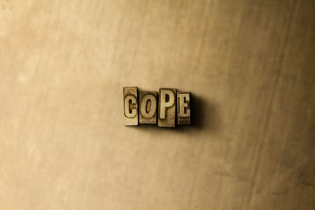 COPE - close-up of grungy vintage typeset word on metal backdrop. Royalty free stock illustration.  Can be used for online banner ads and direct mail. Stock Photo