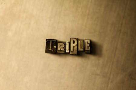 TRIPLE - close-up of grungy vintage typeset word on metal backdrop. Royalty free stock illustration.  Can be used for online banner ads and direct mail.