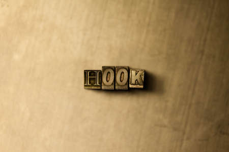 HOOK - close-up of grungy vintage typeset word on metal backdrop. Royalty free stock illustration.  Can be used for online banner ads and direct mail. Stock Photo
