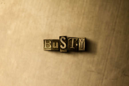 busty: BUSTY - close-up of grungy vintage typeset word on metal backdrop. Royalty free stock illustration.  Can be used for online banner ads and direct mail. Stock Photo