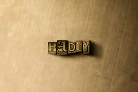 BADLY - close-up of grungy vintage typeset word on metal backdrop. Royalty free stock illustration.  Can be used for online banner ads and direct mail.