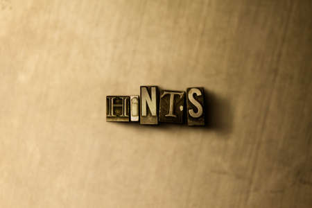 hints: HINTS - close-up of grungy vintage typeset word on metal backdrop. Royalty free stock illustration.  Can be used for online banner ads and direct mail.