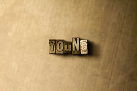 letterpress type: YOUNG - close-up of grungy vintage typeset word on metal backdrop. Royalty free stock illustration.  Can be used for online banner ads and direct mail.
