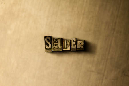 safer: SAFER - close-up of grungy vintage typeset word on metal backdrop. Royalty free stock illustration.  Can be used for online banner ads and direct mail.