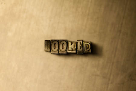 looked: LOOKED - close-up of grungy vintage typeset word on metal backdrop. Royalty free stock illustration.  Can be used for online banner ads and direct mail. Stock Photo