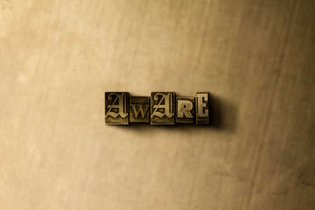 be aware: AWARE - close-up of grungy vintage typeset word on metal backdrop. Royalty free stock illustration.  Can be used for online banner ads and direct mail.