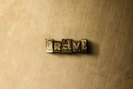 letterpress type: GRAVE - close-up of grungy vintage typeset word on metal backdrop. Royalty free stock illustration.  Can be used for online banner ads and direct mail.