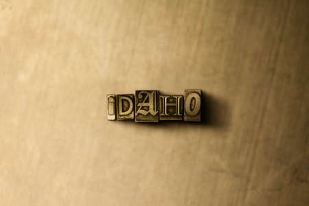 letterpress type: IDAHO - close-up of grungy vintage typeset word on metal backdrop. Royalty free stock illustration.  Can be used for online banner ads and direct mail.