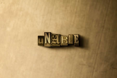 unable: UNABLE - close-up of grungy vintage typeset word on metal backdrop. Royalty free stock illustration.  Can be used for online banner ads and direct mail.
