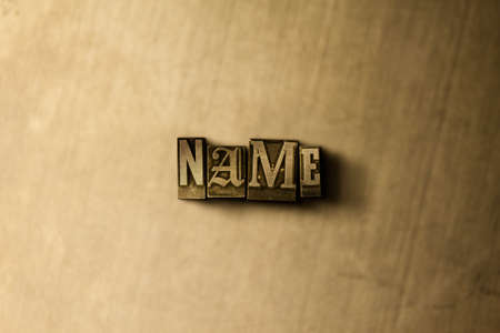 NAME - close-up of grungy vintage typeset word on metal backdrop. Royalty free stock illustration. Can be used for online banner ads and direct mail.