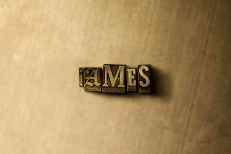 letterpress type: JAMES - close-up of grungy vintage typeset word on metal backdrop. Royalty free stock illustration.  Can be used for online banner ads and direct mail.