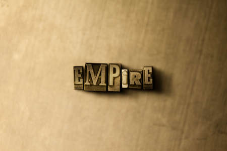 letterpress type: EMPIRE - close-up of grungy vintage typeset word on metal backdrop. Royalty free stock illustration.  Can be used for online banner ads and direct mail.