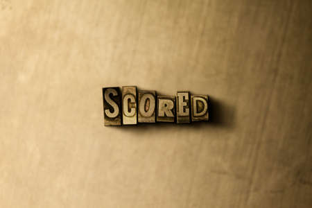 scored: SCORED - close-up of grungy vintage typeset word on metal backdrop. Royalty free stock illustration.  Can be used for online banner ads and direct mail. Stock Photo