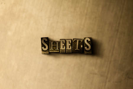 letterpress type: SHEETS - close-up of grungy vintage typeset word on metal backdrop. Royalty free stock illustration.  Can be used for online banner ads and direct mail. Stock Photo