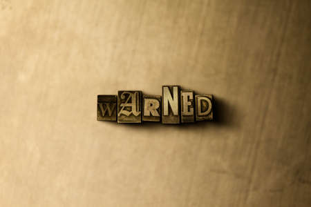 warned: WARNED - close-up of grungy vintage typeset word on metal backdrop. Royalty free stock illustration.  Can be used for online banner ads and direct mail.