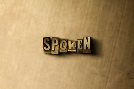 SPOKEN - close-up of grungy vintage typeset word on metal backdrop. Royalty free stock illustration.  Can be used for online banner ads and direct mail.