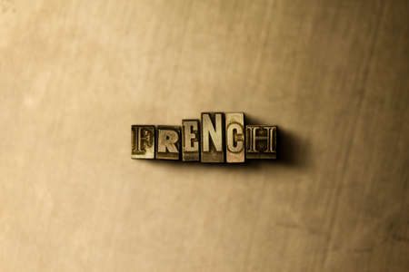 letterpress type: FRENCH - close-up of grungy vintage typeset word on metal backdrop. Royalty free stock illustration.  Can be used for online banner ads and direct mail. Stock Photo