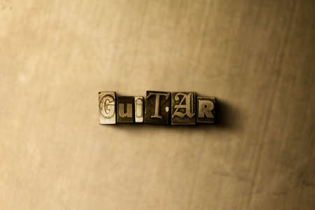 lead guitar: GUITAR - close-up of grungy vintage typeset word on metal backdrop. Royalty free stock illustration.  Can be used for online banner ads and direct mail. Stock Photo