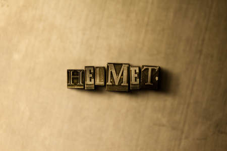 letterpress type: HELMET - close-up of grungy vintage typeset word on metal backdrop. Royalty free stock illustration.  Can be used for online banner ads and direct mail.