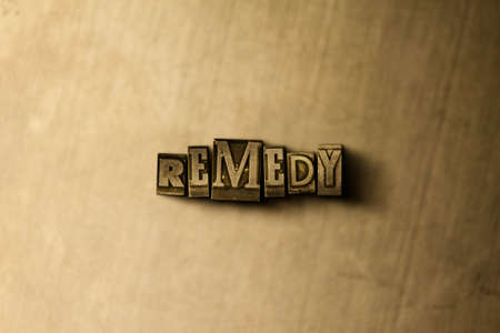 letterpress type: REMEDY - close-up of grungy vintage typeset word on metal backdrop. Royalty free stock illustration.  Can be used for online banner ads and direct mail.