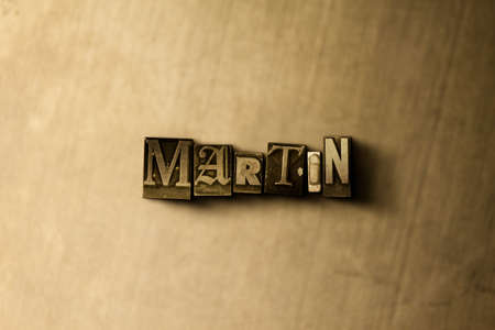 letterpress type: MARTIN - close-up of grungy vintage typeset word on metal backdrop. Royalty free stock illustration.  Can be used for online banner ads and direct mail.