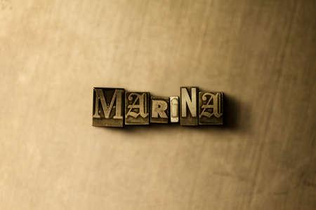 マリーナ - グランジ ビンテージのクローズ アップは、金属の背景上の単語をタイプセットします。ロイヤリティ フリーのストック イラスト素材。  写真素材